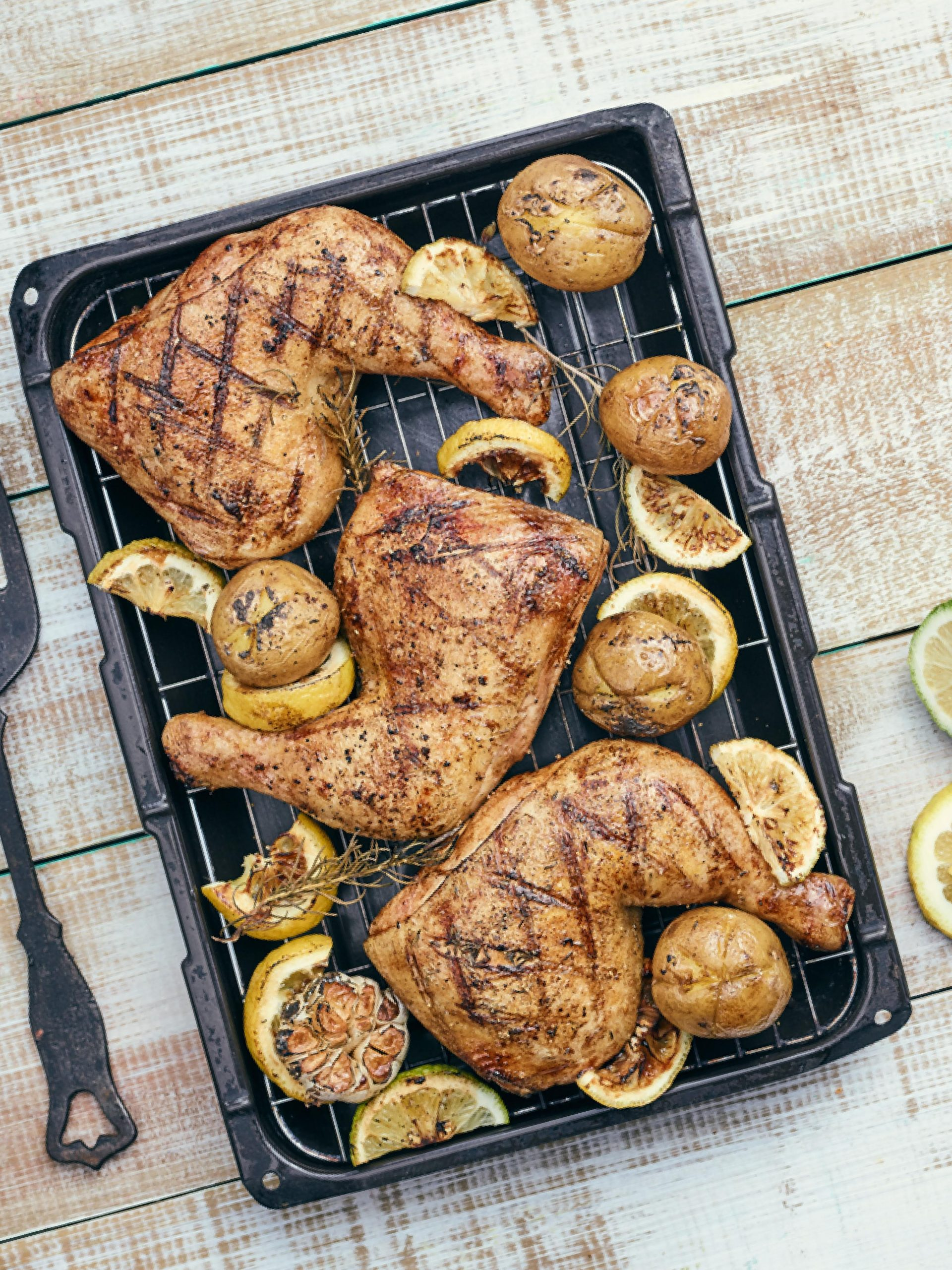 Grilled Chicken with Rosemary Roasted Garlic, Potatoes and Lemon Slices
