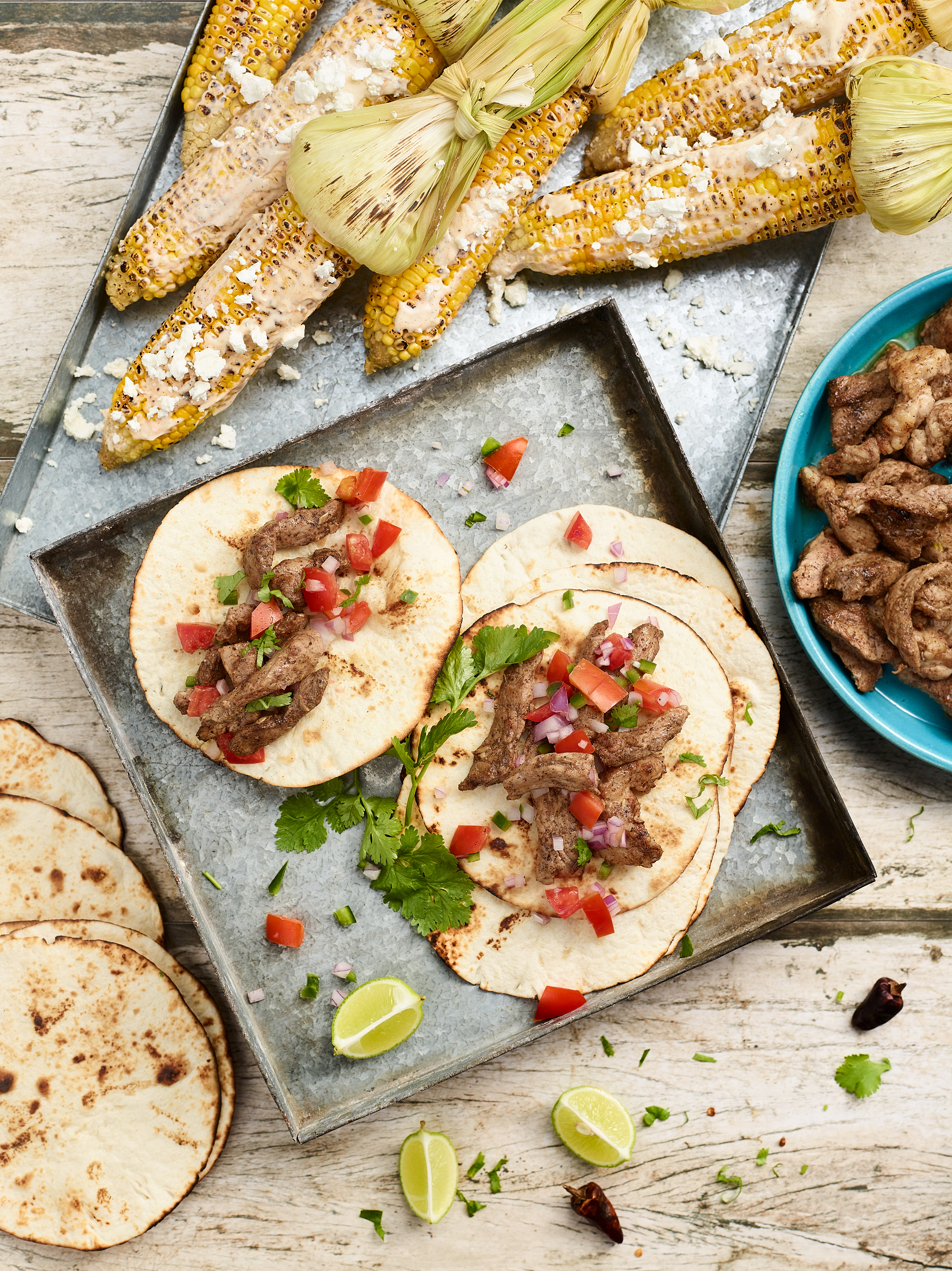 Sizzling Pork Tacos with Mexican Elote
